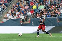 FOXBOROUGH, MA - JULY 25: Wilfrid Kaptoum #5 of New England Revolution passes the ball during a game between CF Montreal and New England Revolution at Gillette Stadium on July 25, 2021 in Foxborough, Massachusetts.