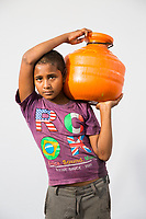 Ramzan Sheikh, 11. Collects 2 pots of water 4-5 times each day from public taps in the drought-hit city of Latur.