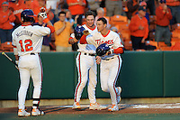 Clemson Tigers  designated hitter Shane Kennedy #11 is greeted by teamates after homering during a game against the Virginia Cavaliers  at Doug Kingsmore Stadium on March 15, 2013 in Clemson, South Carolina. The Cavaliers won 6-5.(Tony Farlow/Four Seam Images).