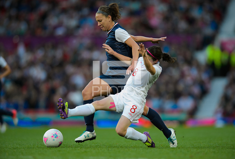 Manchester, England - Monday, August 6, 2012: The USA defeated Canada 4-3 in overtime in the semi-final round of the 2012 London Olympics at Old Trafford. Lauren Chevy and Diana Matheson (8) battle for the ball.