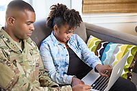 Off duty male US military soldier at home. For sale as stock photography, DOD compliant.