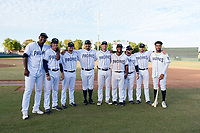 Dauris Valdez (50), Pete Zamora (44), Blake Rogers (55), Travis Radke (80), Hudson Potts (13), Miguel Diaz (36), Doug Banks (8), Austin Allen (24), and Buddy Reed (85), all members of the Peoria Javelinas and San Diego Padres organization, pose for a photo after winning the Arizona Fall League Championship game against the Salt River Rafters at Scottsdale Stadium on November 17, 2018 in Scottsdale, Arizona. Peoria defeated Salt River 3-2 in 10 innings. (Zachary Lucy/Four Seam Images)