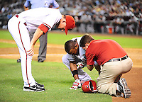 Jun. 21, 2010; Phoenix, AZ, USA; Arizona Diamondbacks manager A.J. Hinch (left) looks on as outfielder Justin Upton is tended to be a team trainer after being hit by a pitch against the New York Yankees at Chase Field. The Diamondbacks defeated the Yankees 10-4. Mandatory Credit: Mark J. Rebilas-