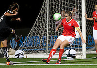 Christine Sincalir (left) kicks the ball against Cat Whitehill (right). FC Gold Pride tied the Washington Freedom 0-0 at Pioneer Stadium in Hayward, California on August 14th, 2010.