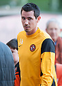 Dundee Utd's new signing Ryan McGowan on the pitch before the start of the game.