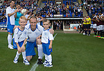 St Johnstone v Hearts...03.08.14  Steven Anderson Testimonial<br /> Steven Anderson with the mascots<br /> Picture by Graeme Hart.<br /> Copyright Perthshire Picture Agency<br /> Tel: 01738 623350  Mobile: 07990 594431