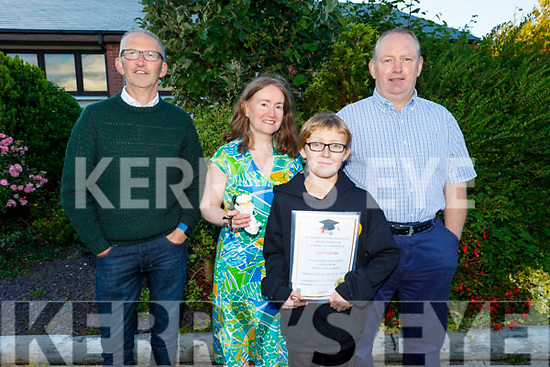 Liam Sheehan graduating from Gaelscoil Mhic Easmainn NS on Thursday standing with his parents Margaret and Pat Sheehan and Pat O'Carroll.