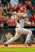 Jacob Mahan #3 of the Arkansas Razorbacks follows through on his swing against the Houston Cougars at Minute Maid Park on March 3, 2012 in Houston, Texas.  The Cougars defeated the Razorbacks 4-1.  (Brian Westerholt/Four Seam Images)