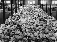 Small portions of the Christmas mail that is being sorted at Pier 86, North River, N.Y.C., for the American Expeditionary Forces.  The mail comes from every part of the country.  November 20, 1918.  Lt. George Lyon. (Army)<br /> NARA FILE #:  111-SC-27163<br /> WAR & CONFLICT BOOK #:  589