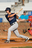 Kyle Knudson #26 of the Elizabethton Twins follows through on his swing against the Johnson City Cardinals at Howard Johnson Field July 3, 2010, in Johnson City, Tennessee.  Photo by Brian Westerholt / Four Seam Images
