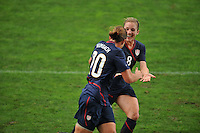 Amy Rodriguez (R), congratulates Abby Wambach on her goal. The USA captured the 2010 Algarve Cup title by defeating Germany 3-2, at Estadio Algarve on March 3, 2010.