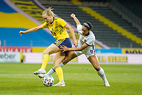 SOLNA, SWEDEN - APRIL 10: Lynn Williams #6 of the United States battles for a ball during a game between Sweden and USWNT at Friends Arena on April 10, 2021 in Solna, Sweden.