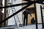 KRASNAYA POLYANA, RUSSIA  - JANUARY 5:<br /> Workers paint the outside of a building at the Gorky Gorod hotel complex in the Mountain Cluster before the start of the 2014 Sochi Olympics Wednesday February 5, 2014<br /> (Photo by Chris Detrick/The Salt Lake Tribune)