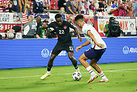 NASHVILLE, TN - SEPTEMBER 5: Antonee Robinson #5 of the United States battles with Richie Laryea #22 of Canada along the sideline during a game between Canada and USMNT at Nissan Stadium on September 5, 2021 in Nashville, Tennessee.
