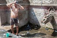 Nepal, Patan.  Man Bathing at a Public Fountain.