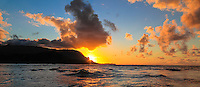 Sunset at Hanalei Bay, with a golden and fiery glow over Mt. Makana (also called Bali Hai), northern Kaua'i.