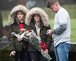 © Joel Goodman - 07973 332324 . 20/12/2017. Manchester, UK. The funeral of 14-year-old Sam Berkley at Christ Church in Denton , East Manchester . Mourners wear red and white , the colours of Hattersley FC , for whom Berkley played . Amongst their number are pupils and friends from Audenshaw School . Berkley died after being hit by a grey BMW near junction 3 of the M67 in Hyde , East Manchester , on 1st December 2017 . Photo credit : Joel Goodman