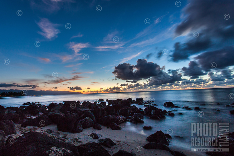 Sunset view from the rocky shoreline of Leftover's (or Leftovers) Beach, North Shore, Oahu.