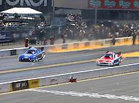 Jul. 28, 2013; Sonoma, CA, USA: NHRA funny car driver Bob Tasca III (right) races alongside Robert Hight during the Sonoma Nationals at Sonoma Raceway. Mandatory Credit: Mark J. Rebilas-
