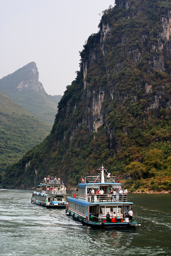 Boats cruising the Lijiang River, Guanxi, China