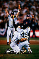 Joe Girardi and Mariano Rivera of the New York Yankees celebrate winning the 1998 World Series against the San Diego Padres at Qualcomm Stadium in San Diego, California. (Larry Goren/Four Seam Images)