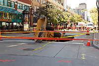 August 5, 2013 File Photo - <br /> Sinkhole swallows backhoe in downtown Montreal.<br /> <br /> The hole opened up at at about 9 a.m. ET at the intersection of Guy and Ste-Catherine streets. It measures about eight metres long, five metres across, and three metres deep.