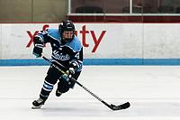 BOSTON, MA - JANUARY 04: Liga Miljone #4 of University of Maine brings the puck forward during a game between University of Maine and Boston University at Walter Brown Arena on January 04, 2020 in Boston, Massachusetts.