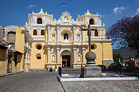 Antigua, Guatemala.  Facade of La Merced Church, completed 1767, decorated in ataurrique style.  Our Lady of Mercedes in the center, flanked by San Raymundo Nonnatus (left) and Bishop San Pedro Pascual (right).