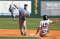 Memphis Tigers second baseman Chad Zurcher #2 turns a double play against the Rice Owls in NCAA Conference USA baseball on May 14, 2011 at Reckling Park in Houston, Texas. (Photo by Andrew Woolley / Four Seam Images)