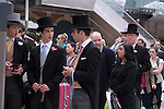 Waterloo Train Station, men in top hat and tail coats buying train tickets for Ascot. Royal Ascot horse racing Berkshire. 2012