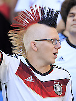 A Germany fan with a mohawk dyed with the national colours