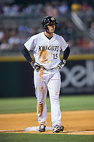 Trayce Thompson (15) of the Charlotte Knights takes his lead off of third base against the Norfolk Tides at BB&T BallPark on April 9, 2015 in Charlotte, North Carolina.  The Knights defeated the Tides 6-3.   (Brian Westerholt/Four Seam Images)