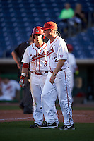 Ball State Cardinals Roman Baisa (3) talks with head coach Rich Maloney (2) during a game against the Louisville Cardinals on February 19, 2017 at Spectrum Field in Clearwater, Florida.  Louisville defeated Ball State 10-4.  (Mike Janes/Four Seam Images)
