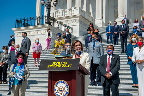 Speaker of the United States House of Representatives Nancy Pelosi (Democrat of California) offers remarks while she is joined by other members of Congress on the House steps of the US Capitol, for a press conference ahead of the vote on the George Floyd Justice in Policing Act of 2020 in Washington, DC., Thursday, June 25, 2020.<br /> Credit: Rod Lamkey / CNP/AdMedia