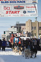 Michael Baker and team leave the ceremonial start line with an Iditarider at 4th Avenue and D street in downtown Anchorage, Alaska on Saturday March 2nd during the 2019 Iditarod race. Photo by Brendan Smith/SchultzPhoto.com