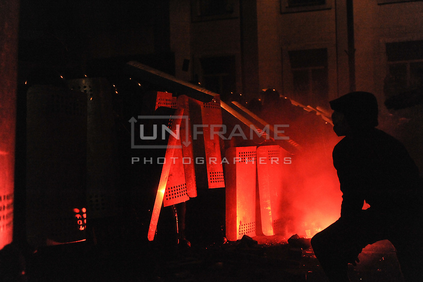 Riot police (Bekrut) defending the Kiev city council building, attacked by the protester as a consequence of  the Ukrainian  government's decision to stall on a deal that would bring closer ties with the European Union.