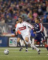Chicago Fire defender Daniel Woolard (24) dribbles as New England Revolution defender Kevin Alston (30) defends. The New England Revolution tied the Chicago Fire, 0-0, at Gillette Stadium on October 17, 2009.