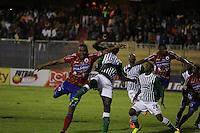 PASTO -COLOMBIA, 03-11-2013. Yerri Mina (Der.) jugador de Pasto disputa el balón con Orlando Berrio (Izq.) jugador de At. Nacional durante del partido por la fecha 17 de la Liga Postobon II-2013, jugado en el estadio Departamental Libertad de la ciudad de Pasto. / Yerri Mina (R) player of Pasto vies for the ball with Orlando Berrio (L) of At. Nacional during a match for the 17th  date of the Postobon Leaguje II-2013 at the Departamental Libertad Stadium in Pasto city. Photo: VizzorImage/STR