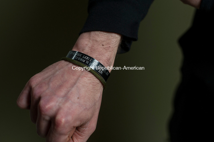 WATERBURY, CT- 23 May 2016-052316EC19-  Matt Harrington served in Iraq and Afghanistan. He wears a bracelet honoring Army Sgt. Ralph N. Porras, who died September of 2006 Serving During Operation Iraqi Freedom. Erin Covey Republican-American