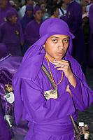 Antigua, Guatemala.   A Cucurucho after Finishing his Turn accompanying a Religious Procession during Holy Week, La Semana Santa.