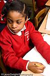 Parochial School Bronx New York  Kindergarten portrait of girl looking to side vertical