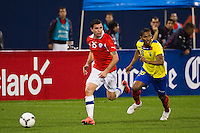 Eugenio Mena (15) of Chile is marked by Antonio Valencia (16) of Ecuador. Ecuador defeated Chile 3-0 during an international friendly at Citi Field in Flushing, NY, on August 15, 2012.