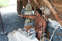 Native Hawaiian man giving Hawaiian cultural workshop in Pu'uhonua o Honaunau National Historical Park, Big Island.