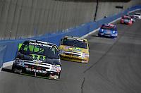 Feb 21, 2009; Fontana, CA, USA; NASCAR Camping World Truck Series driver Ricky Carmichael races into turn three during the San Bernardino County 200 at Auto Club Speedway. Mandatory Credit: Mark J. Rebilas-