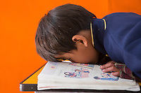 A visually impaired Tibetan student reads a Chinese text book during a lesson at the School for the Blind in Tibet, in the capital city of Lhasa, September 2016.