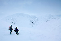 Two walkers looking towards Stob Coire an t-Sneachda and Cairn Lochan from the Central Cairngorm Plateau, Cairngorm National Park, Badenoch & Speyside