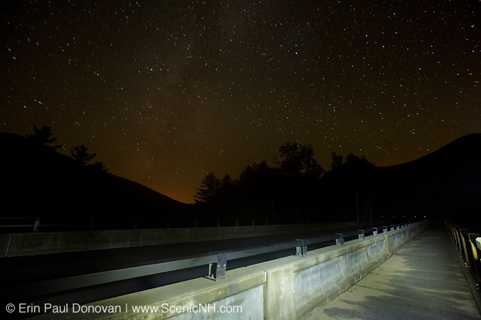 Star trails along the Kancamagus Scenic Byway (Route 112) in Lincoln, New Hampshire USA during the summer months.