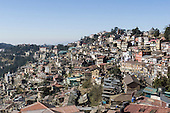 Shimla, Himachal Pradesh, India. View of the jumble of buildings cascading down the hillside which form the centre of the city.