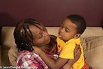 3 year old boy at home talking with his grandmother
