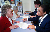 Paddington Churches Housing Association reception staff advising tenants.